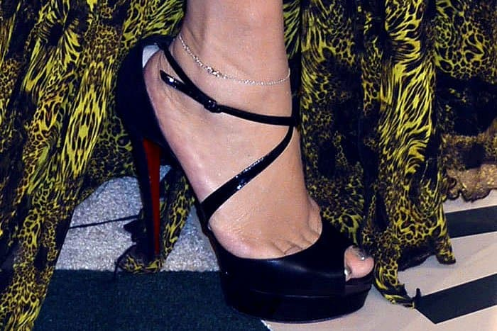 "Mariah Carey's feet in Christian Louboutin ""Cross Me"" peep-toe platform pumps"