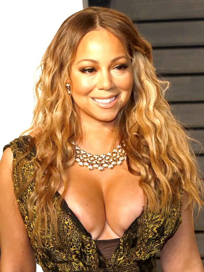 Mariah Carey's breasts being pinched in a Philipp Plein spring 2017 low-cut leopard-print gown