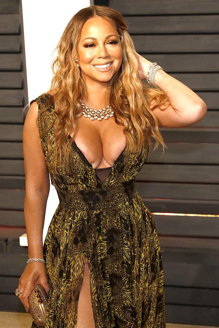 Mariah Carey partially exposing her nipple and bikini