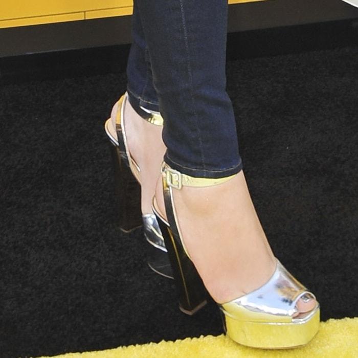 Mariah Carey wearing towering sky-high silver heels