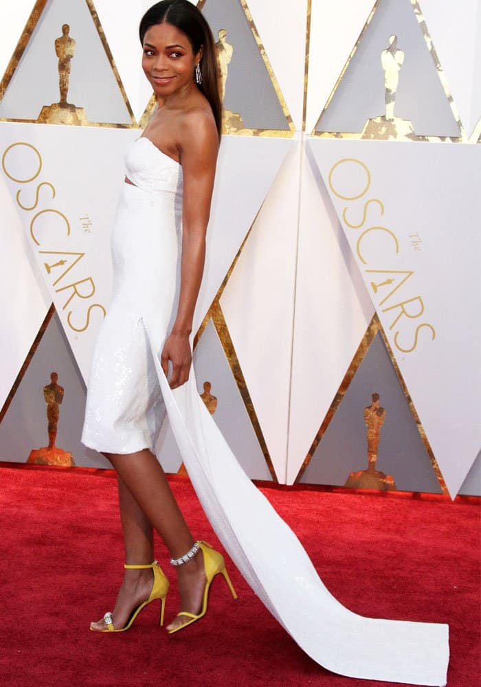 Naomie shuns the long gowns and slips into a Calvin Klein cocktail dress with a train
