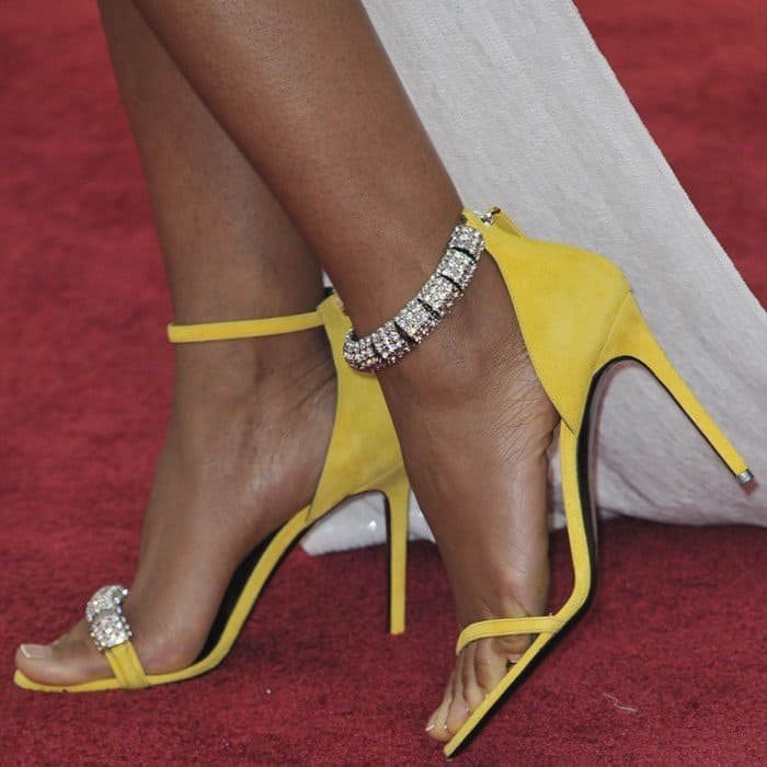 Naomie Harris in yellow Calvin Klein sandals