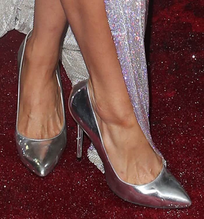 "Paris Hilton wearing a sparkly August Getty dress and silver Charlotte Olympia ""Monroe"" pumps"