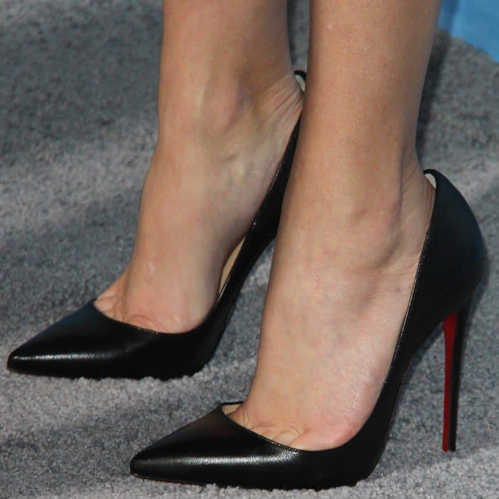 Reese Witherspoon reveals toe cleavage in black patent Christian Louboutin pointy-toe pumps