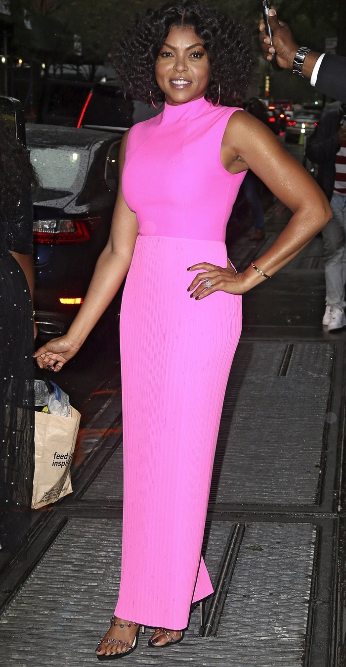 Taraji P. Henson kept it bright in a pink dress while making her way out of The View studios after making an appearance in New York City on September 25, 2018