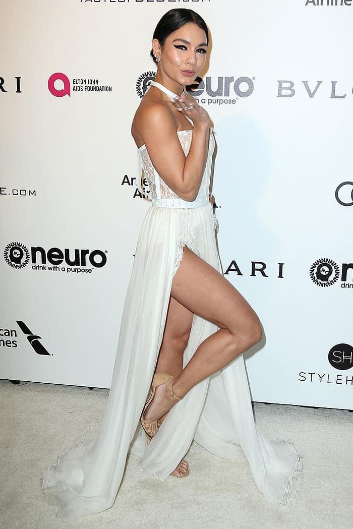 Vanessa Hudgens flashing leg in a white Kristian Aadnevik double-slit gown and Stuart Weitzman 'Nudist' sandals