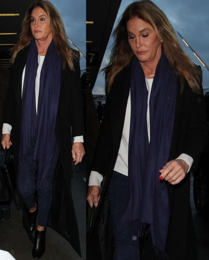 Caitlyn Jenner wearing black leather ankle boots at LAX