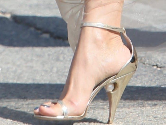 "Freida Pinto's metallic gold ""Penelope"" sandals from Nicholas Kirkwood"