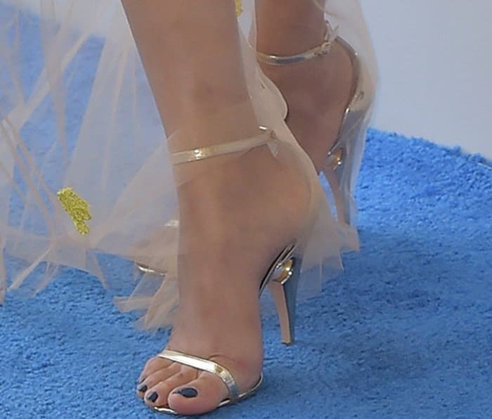 Freida Pinto showing off her feet in sandals from Nicholas Kirkwood
