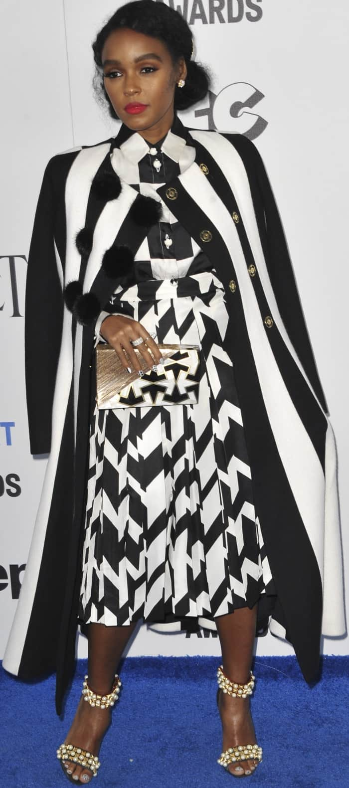 Janelle Monáe wearing a Salvatore Ferragamo monochromatic ensemble and Christian Louboutin 'Tudor Bal' Sandals