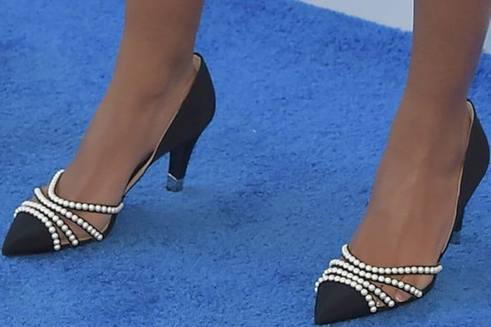 Naomie Harris wearing black pearl-embellished pumps from Chanel