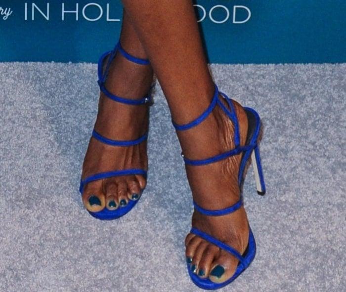 Yvonne Orji wearing electric blue Stuart Weitzman sandals