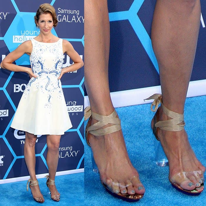 Alysia Reiner with her pinkie toes desperately trying to fit into the clear straps of her ankle-ribbon sandals at the 2014 Young Hollywood Awards at the Wiltern Theatre in Los Angeles, California, on July 27, 2014.