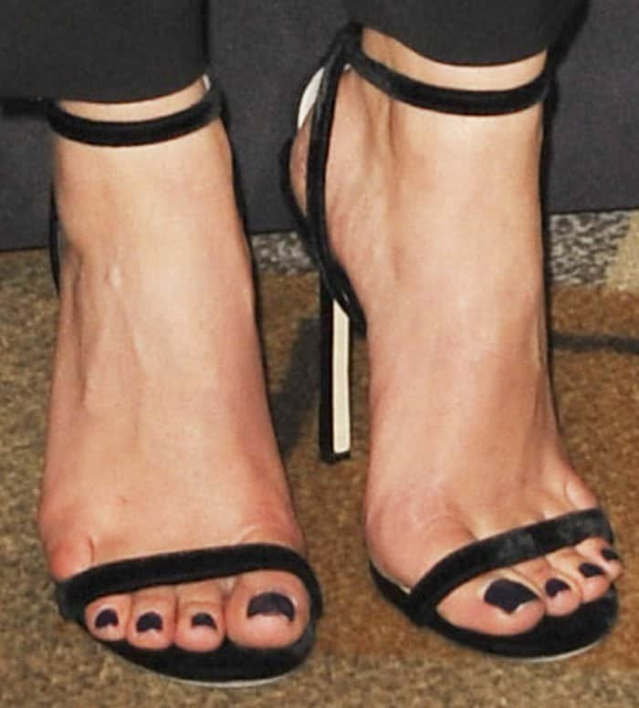 """Ashley styled her look with a pair of velvet Jimmy Choo """"Minny"""" sandals"""