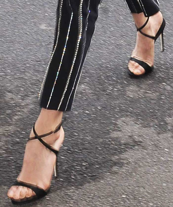 Bella exchanged her usual trainers for a sophisticated pair of Giuseppe Zanotti Dionne sandals