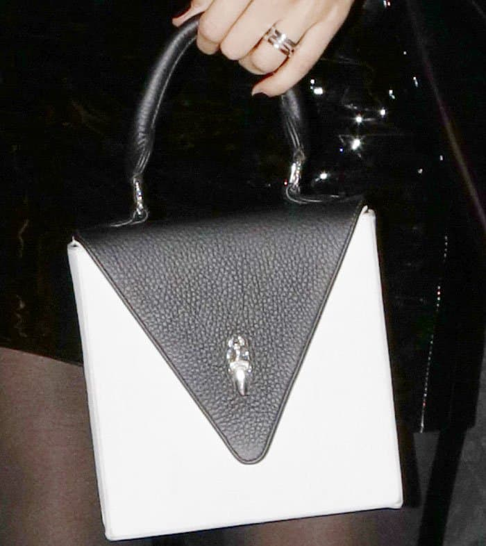 Bella shows off a square bag from her Chrome Hearts x Bella Hadid line