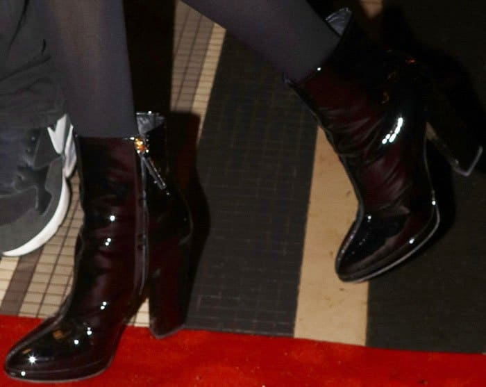 Bella looked chic in a pair of Giuseppe Zanotti patent boots