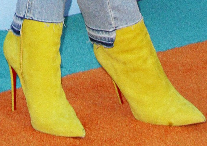 Blac Chyna added a pop of color to her outfit with yellow Christian Louboutin So Kate boots