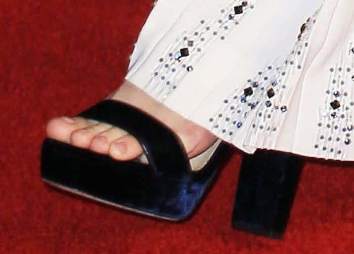 Brie's Jimmy Choo Holly sandals peep out from under her dress
