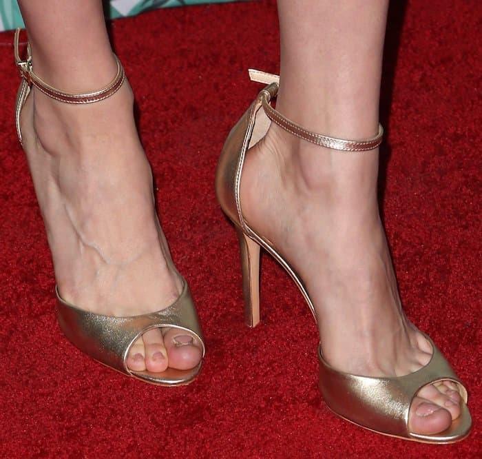 Brie Larson in Schutz Saasha Lee gold sandals Women in Film Pre Oscars Party