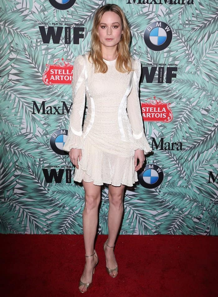 Brie Larson in Alexander McQueen white dress at Women in Film Pre Oscars Party