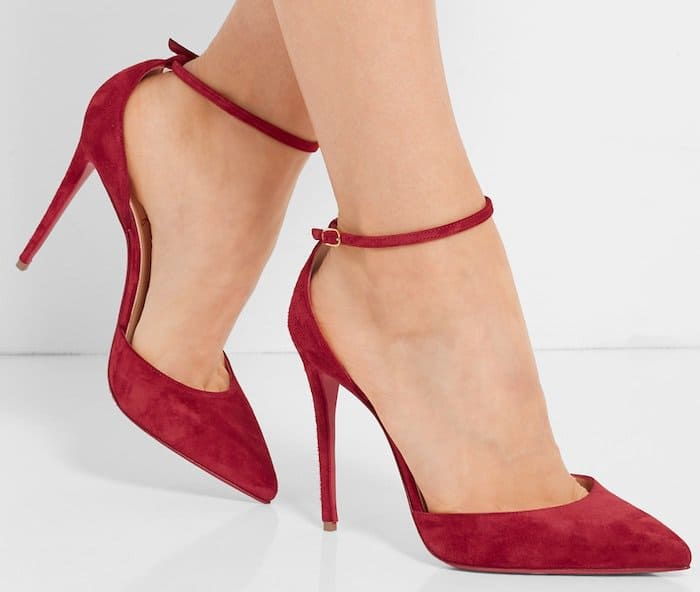 This pair is designed with a slender heel, ankle strap and sleek point-toe silhouette