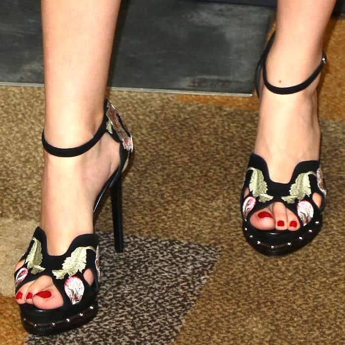 Alexander McQueen poppy-embroidered sandals on Christian Serratos.