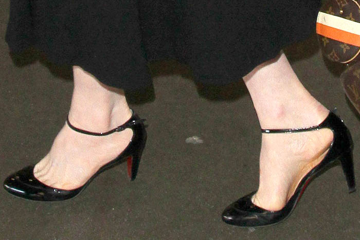 Dita Von Teese's feet in Christian Louboutin ankle-strap pumps with low heels