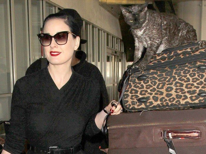 Dita Von Teese traveling with her Devonshire Rex cat named Alestier at the Los Angeles International Airport (LAX) in Los Angeles, California, on March 6, 2017.