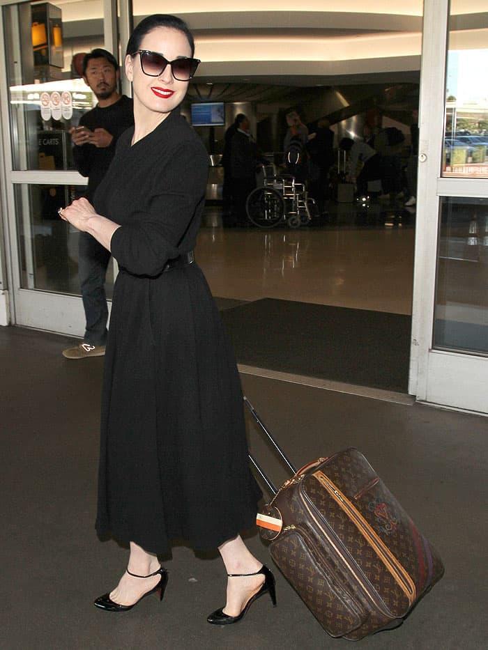 Dita Von Teese rocks a black '50s-style wrap dress