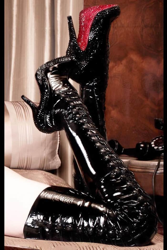 Dita Von Teese's Instagram post of her one-of-a-kind, patent leather thigh-high boots with Swarovski crystallized soles inspired by the art of John Wille and custom-made for her by Christian Louboutin