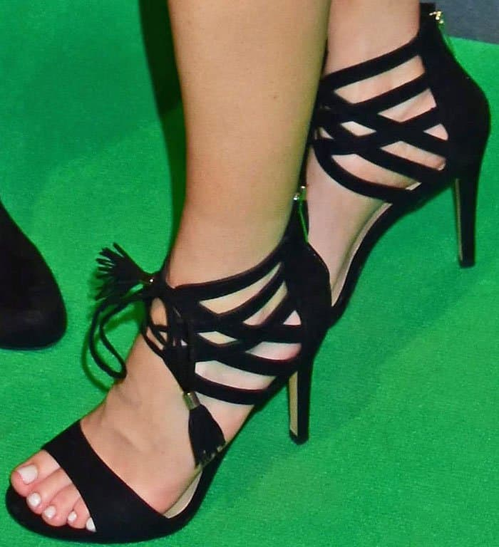 Ellie launches her shoe line with the star of the show: a pair of ankle strap sandals
