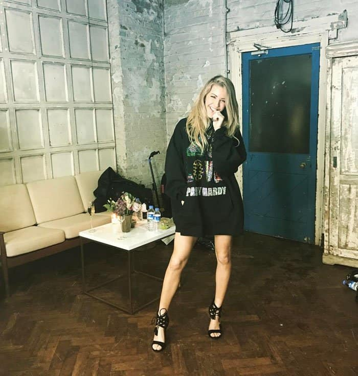 Ellie posing with her shoes backstage right before her performance
