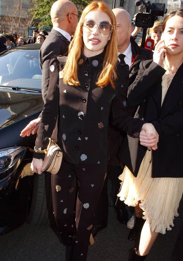 Emma nervously makes her way through the Paris crowd