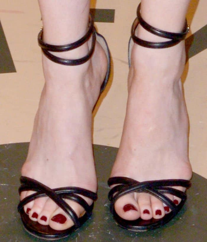 Emma wears a pair of strappy Givenchy sandals
