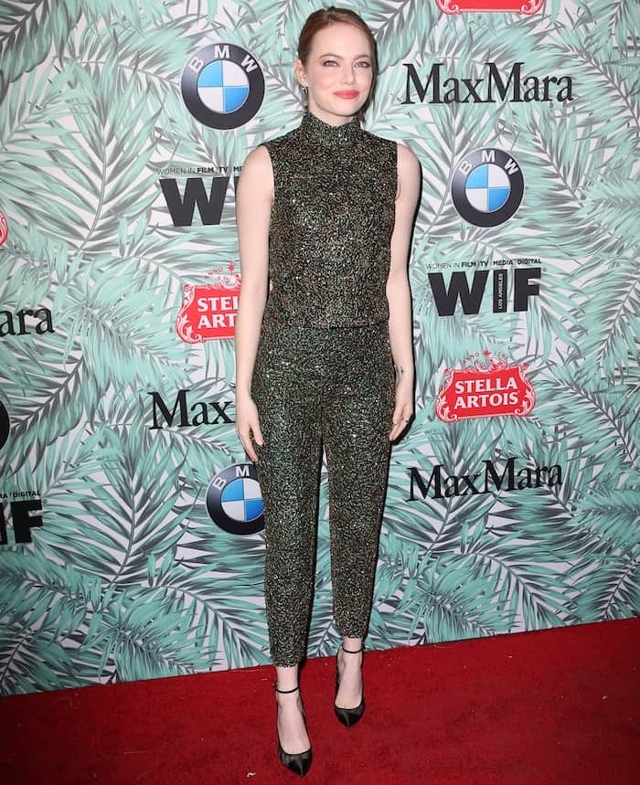 Emma Stone in an embellished pantsuit from Prada for the Women in Film Pre Oscars Party at Nightingale Plaza in Hollywood on February 24, 2017