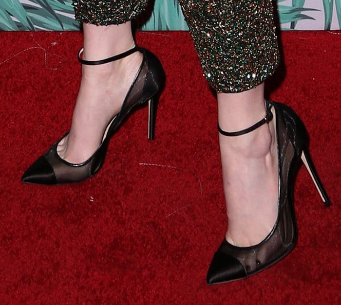 Emma shows off her feet in Jimmy Choo Tower pumps