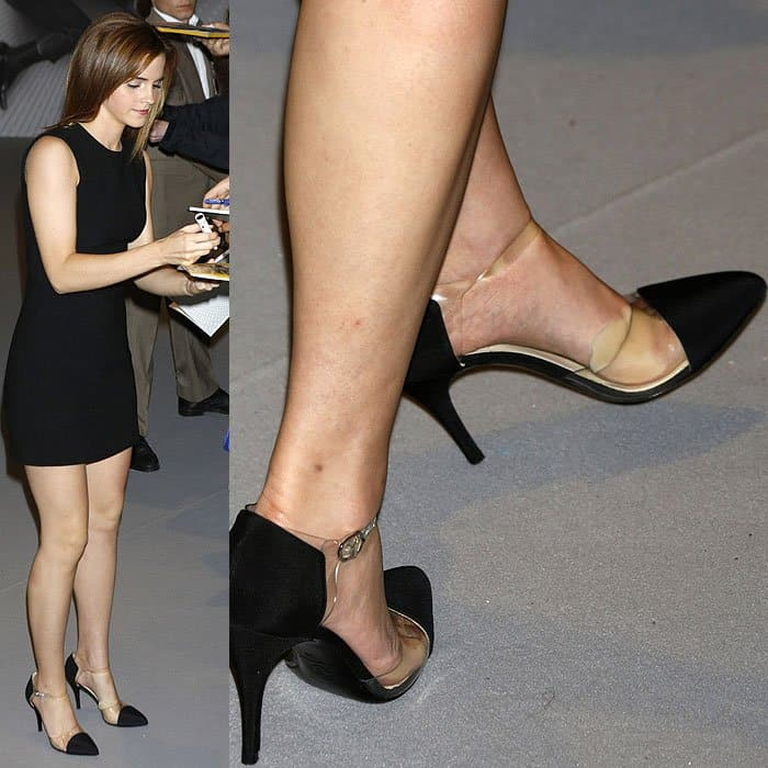 Emma Watson with a twisted left ankle strap and a shoe insert falling out of her Chanel PVC-and-satin pumps