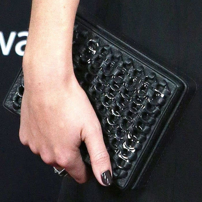 Detail of Emma Watson's custom Bottletop clutch crafted from zero-deforestation leather and embellished with metal soda can tabs.