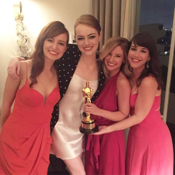 Emma poses with her best friends