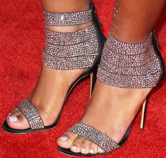Normani wears a pair of embellished satin sandals