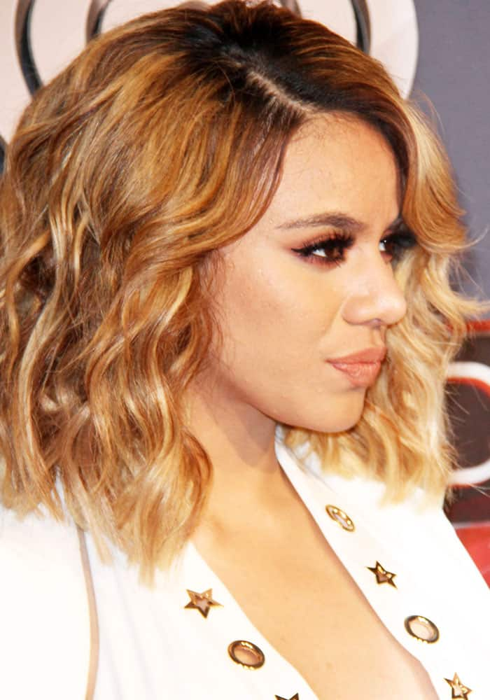 Dinah stands out in a white ensemble