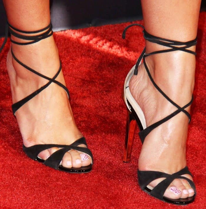 Dinah amps up the sexiness in her look with a pair of Jimmy Choo Teira sandals