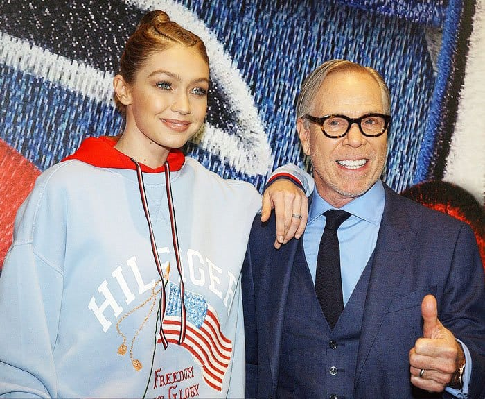 Gigi poses with the head designer himself, Tommy Hilfiger