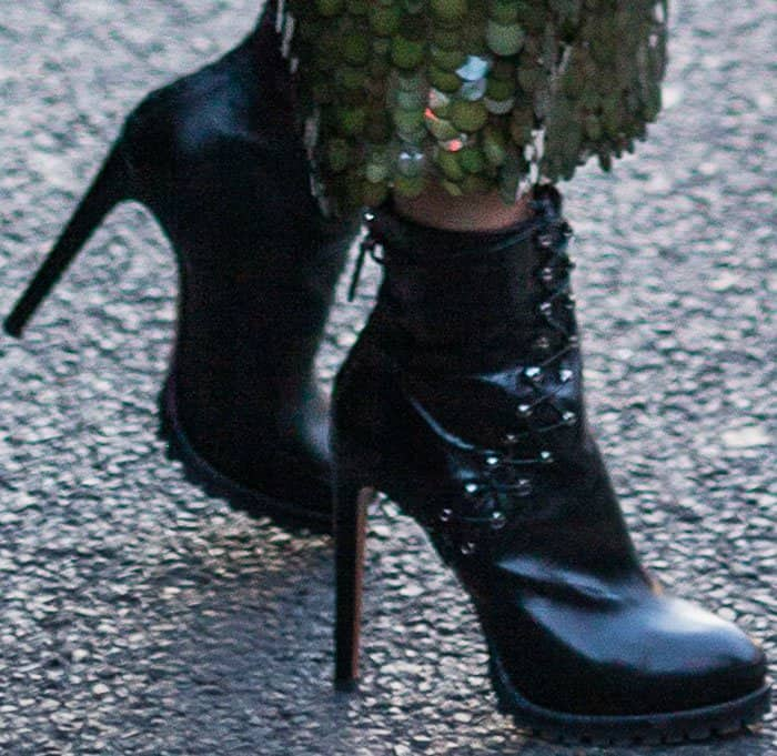Two birds with one stone: Hailey wore her Alaïa boots for two Paris looks