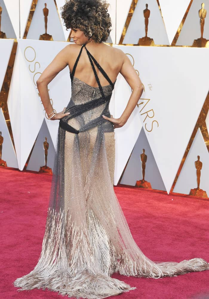 Halle Berry'sbeautiful sheer dress was covered in embellishments, and trailed down to an airy hem