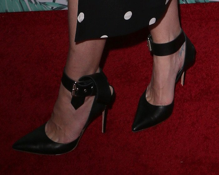 Jaime King in Monse ankle strap pumps