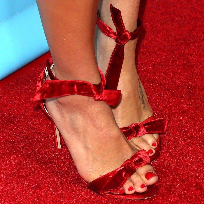 "Jenna Dewan Tatum's feet in Alexandre Birman ""Clarita"" red-velvet bow sandals"