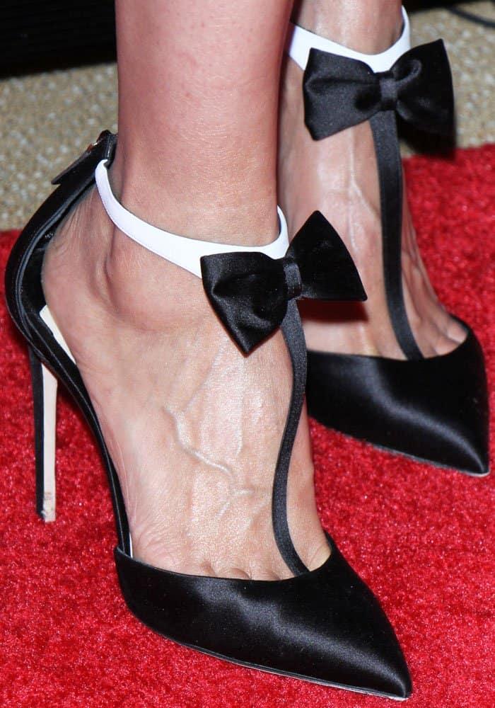 """Jennifer wears the tuxedo-inspired Olgana Paris """"La Garconne"""" pumps"""