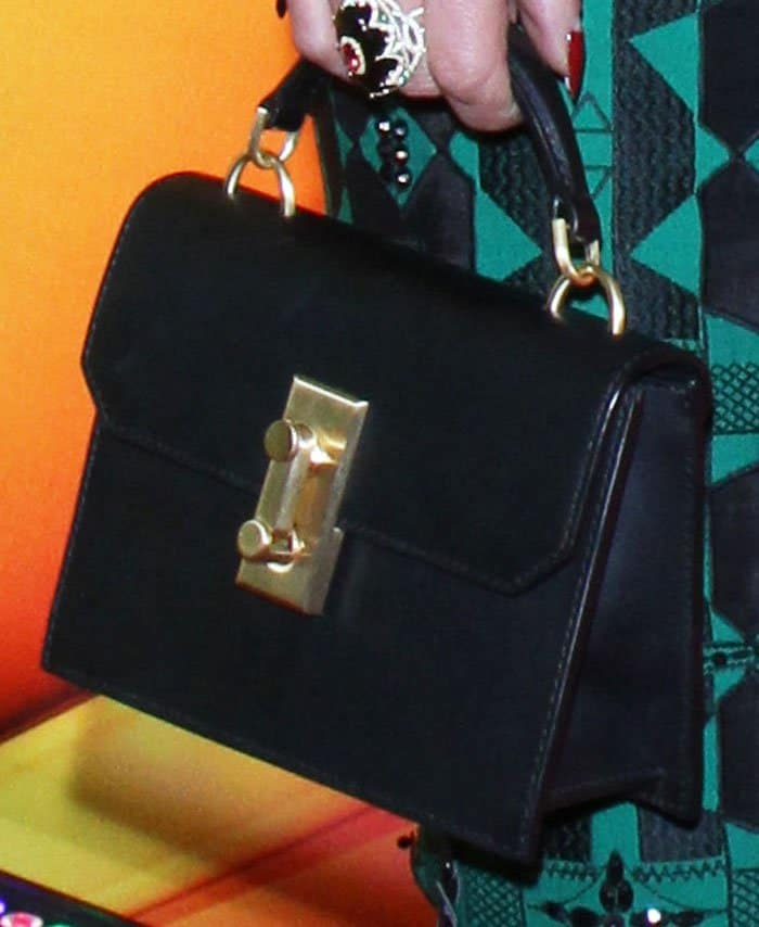 The actress pairs her quirky look with a black structured bag
